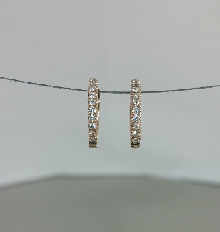 14 Karat Rose Gold Diamond Huggie Earrings (0.16ct)