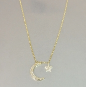 14 Karat Yellow Gold Diamond Moon and Star Necklace (0.11ct)