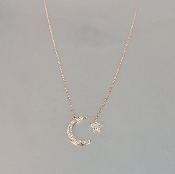 14 Karat Rose Gold Diamond Moon and Star Necklace (0.11ct)