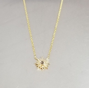 14 Karat Yellow Gold White Topaz Dia. Sunburst Necklace (0.06ct)