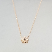 14 Karat Rose Gold White Topaz Dia. Sunburst Necklace (0.06ct)