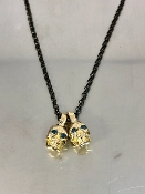 14 Karat Yellow Gold Blue Diamond Evil Twins Skull Necklace