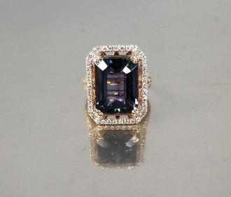 14 Karat Rose Gold Tanzanite Diamond Ring (12.23/0.82ct)