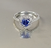 14 Karat White Gold Blue Sapphire Diamond Ring (1.25/0.18ct)