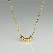 7 Wishes Gold Barrel Necklace
